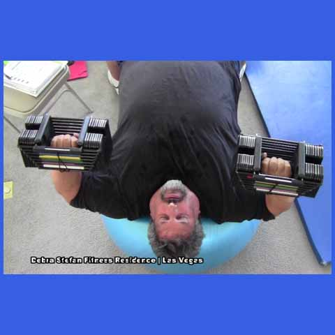 PowerBlock Dumbbells-500Lb Man Doing Chest Press on Duraball