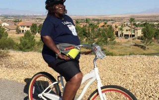 Senior woman bikes, hikes and lifts weights at Debra Stefan Fitness biking retreat 4-week program.