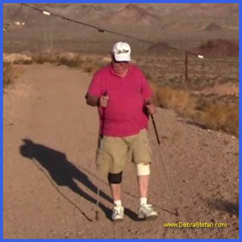 Trekking Poles- Elderly man walking with poles.