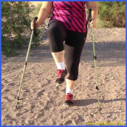 Trekking Poles-Woman exercising with poles.