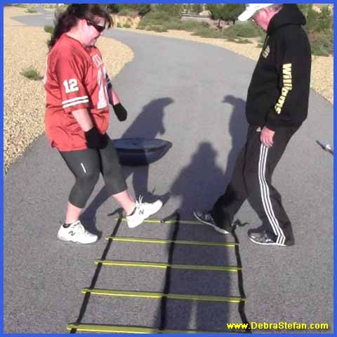 Senior man and woman training on the Double Agility ladder.
