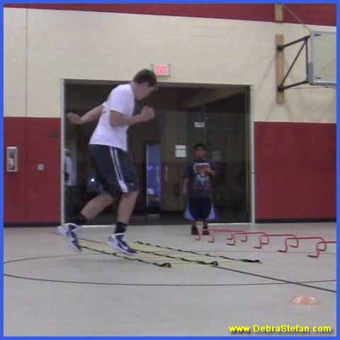 Youths train on Agility ladder with for foot speed variations, balance and conditioning.