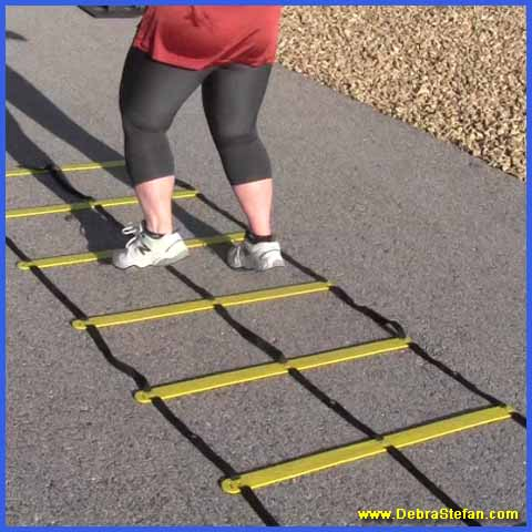 Senior woman training on the Double Agility ladder.
