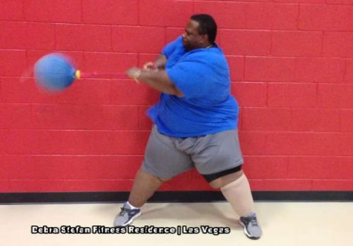 Morbidly Obese Man Performing Extreme Converta-Ball Rotations.
